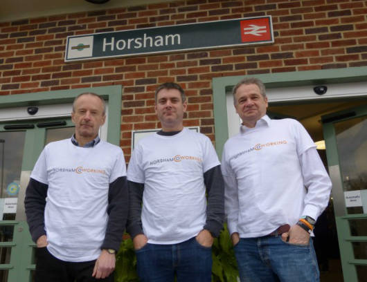 Clive, Matt and Roger wearing Horsham Coworking T-shirts outside Horsham Station